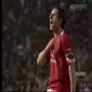 Gary Neville celebrating united scoring in front of the liverpool fans