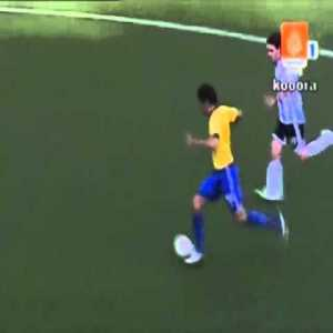 Kaka and Messi run with the ball in 2006