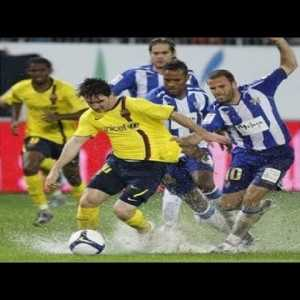 Lionel Messi vs horrible wet pitch on a cold rainy night in Malaga.