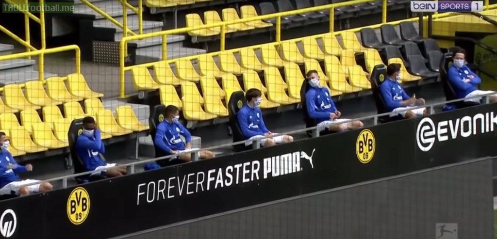 Schalke bench practicing social distancing...