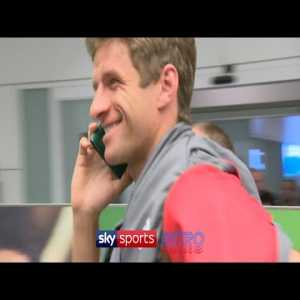 Muller uses passport as phone to avoid reporters.