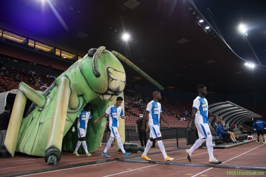 The Swiss team Grasshoppers now walks on the pitch through a giant inflatable grasshopper.