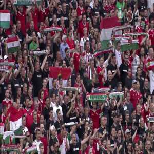 Hungarian fans and players singing the national anthem after the match against Portugal