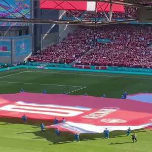 Giant Christian Eriksen jersey on the field before Denmark-Belgium