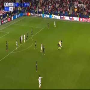 Sučić circling around 2 players and a ref