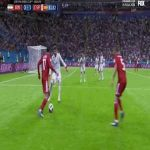 Vahid Amiri (Iran) nutmegs Gerard Pique (Spain)