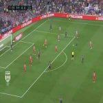 Messi dribbling past Girona players near the 18 yard box