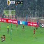 CAF Confederation Cup, RS Berkane vs Raja Casablanca. A Berkane defender pulls a Raja player's shirt in the box so hard it gets stripped off. No penalty given