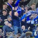 Premier League referee Mike Dean celebrates Tranmere's win at Forest Green