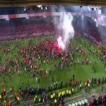 Union Berlin fans storm the pitch as their club gets promoted to the Bundesliga for the first time