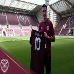 Hearts have completed the transfer of Jamie Walker from Wigan Athletic, subject to international clearance.