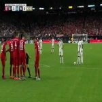 "Bayern Munich's Niklas Süle standing in the wall, laughing and saying ""try"" to Rodrygo Goes before the Real Madrid youngster puts it in the top bin"