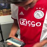 Edson Alvarez sees his own announcement video and gets emotional.