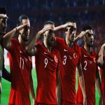 Turkish players celebrating their winning goal with a military salute