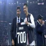Ronaldo presented with a Juve jersey that shows 700 goals.