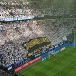 Schalke 04 fans with massive stolen Borussia Dortmund banner