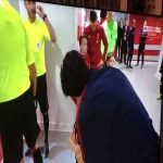 Bellerin giving his tracksuit top to the young mascot