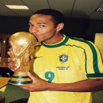 Thierry Henry kissing the World Cup trophy in Ronaldo's famous number 9 Brazil shirt (1998)
