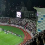 Every Kosovo fan holds up an England flag during the national anthem, while a giant 'Welcome & Respect' banner is shown behind the goal