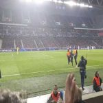 Pitch invader at Lille Ajax helps up steward who fell down