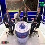 Patrice Evra lifting Graeme Souness' glass up to check what's in it after he says it was never a foul on De Gea