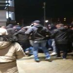 Angry PSV ''Supporters'' storming the enterance of the Philips Stadion after the game against FC Twente finished 1-1. Riot police had to intervene