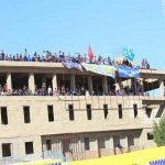 Fans of Iraqi club Al-Najaf gathered at a nearby building watch their match which was behind closed doors due to coronavirus