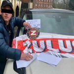 A Birmingham City fan has gone to the location of the Jack Grealish crash and stuck a Zulu Warriors and BCFC flag on top of the actual damaged car