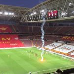 Stoppage in play during the Galatasaray-Fenerbahce match due to flares thrown onto the pitch. There are no fans in attendance. The flare came from the outside.