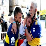 Fans of Boca Juniors and River Plate mourning the loss of Diego Armando Maradona in his funeral