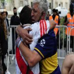 River Plate and Boca Juniors fans hugs while crying for Diego Maradona's death