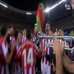 Athletic players celebrating their Super Cup win with Asier Villalibre playing on the trumpet.