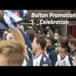 Founding member of the football league Bolton Wanderers win promotion to League One the season after almost going out of business