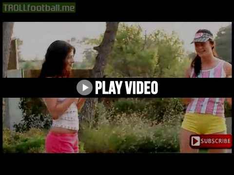Two lesbian play ball in garden